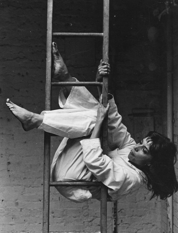 "Elaine Summers on a ladder in her work ""Theater Piece for Chairs and Ladders"", 1965. Photo © by Dan Budnik. all rights reserved"